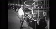 Factory workers working on the final assembly line Stock Footage