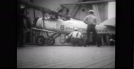 Biplane taking off from deck of USS Saratoga (CV-3) Stock Footage
