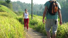 People on trip greeting each other while hiking through terraces in Bali HD Stock Footage