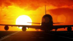 Jet plane departs from airport runway as silhouette in front of large sunset - stock footage