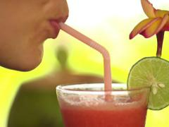 Close up of woman face drinking fruit cocktail through straw NTSC Stock Footage