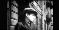 Jewish boy standing on city street Stock Footage