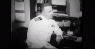 Naval officer discussing evacuation plan with diplomat Stock Footage