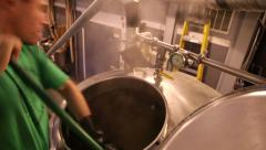 1295 - Brewmaster mixing the brew tank Stock Footage