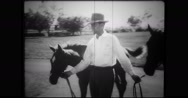 Ben Jones walking with thoroughbreds Stock Footage