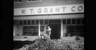 Worker cleaning flooded shops Stock Footage