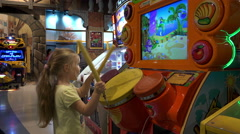 Child knocks bonuses and score points on the slot machine Stock Footage