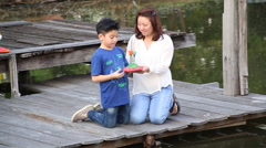 Happy asian mother and son in LOY KATHONG Festival Stock Footage