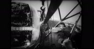 Mechanic attaching propeller to B-17 bomber Stock Footage