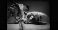 Armourer loading ammunition belt into the machine gun Stock Footage