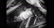 Mechanics loading aerial bomb into weapons bay Stock Footage