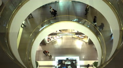 People move to different floors of the shopping complex Stock Footage
