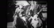 Trainers riding thoroughbreds Stock Footage