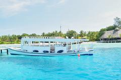 passenger boat in clear waters - stock photo