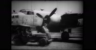 Military troop getting off from van and boarding a B-25 Mitchell bomber Stock Footage