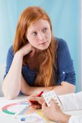 gynaecologist prescribing young girl contraceptive pills - stock photo