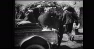 Military soldiers loading goods in cart Stock Footage