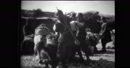 Camels being loaded up for quartermaster supplies by Italian soldiers Stock Footage