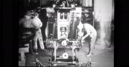 Factory workers assembling steering gear Stock Footage