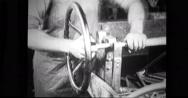 Factory worker assembling steering gear Stock Footage