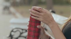 The girl opens the thermos and pours tea in the park Stock Footage