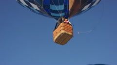 Blue hot air balloon flying in sky Stock Footage