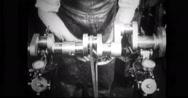 Factory worker checking balance of crankshaft Stock Footage