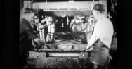 Factory workers lifting the frame Stock Footage