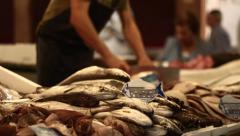 Food Market. Grocery. Fishmonger slincing fish. Stock Footage