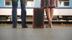 Pair at the station with a suitcase Stock Footage
