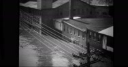 River raging with flood water on street Stock Footage