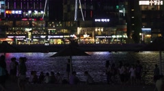 Waterfront Busan At Night Crowds At Gwangalli Beach 4K Stock Footage