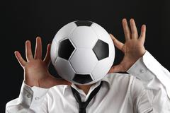 Attractive man with white shirt and football Stock Photos