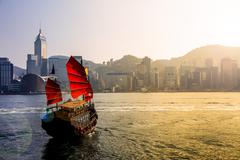 Junkboat and hong kong city Stock Photos