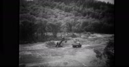 Excavator dredging riverbed to reinforce the banks Stock Footage