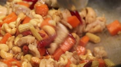 Woman cooking chicken and vegetables Stock Footage