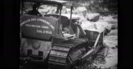 Bulldozer dredging riverbed to reinforce the banks Stock Footage