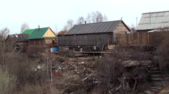 Wooden log houses of russian village Stock Footage