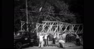 Engineers constructing bailey bridge Stock Footage