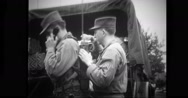 Military officer talking on field telephone Stock Footage