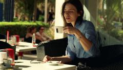 Happy businesswoman mixing coffee in cafe city HD Stock Footage