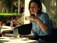 Happy businesswoman mixing coffee in cafe city NTSC Stock Footage