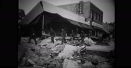 Military soldiers walking across ruined building Stock Footage