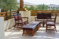 Outdoor furniture rattan armchairs and table on terrace Stock Photos