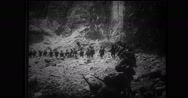 Japanese military soldiers walking down mountainside Stock Footage