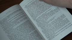 flipping pages of a english book - stock footage
