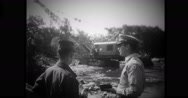 Military officer checking the progress of work at riverbed Stock Footage
