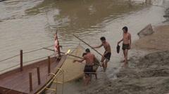 Fishermen haul nets - stock footage