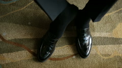 The man wears shoes. Close up Stock Footage