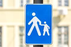 Stock Photo of Pedestrians And Children Crosswalk Sign